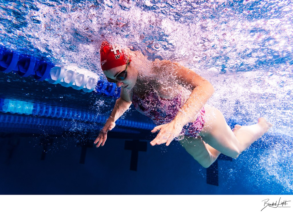 Underwater image of butterfly swimmer mid stroke