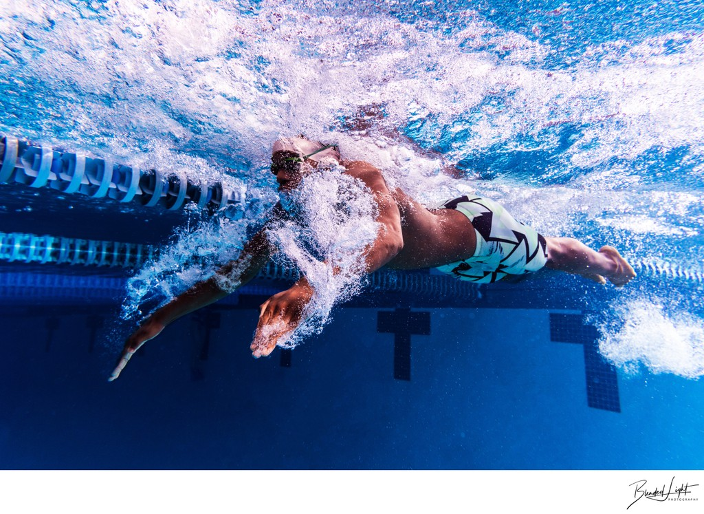 Underwater image of butterfly stroke with local swimmer