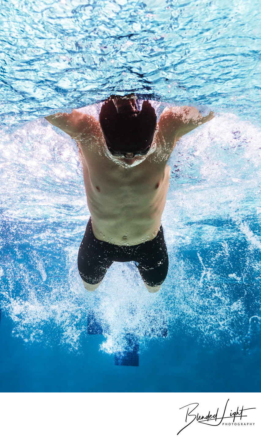 Tight Butterfly swim image of male swimmer