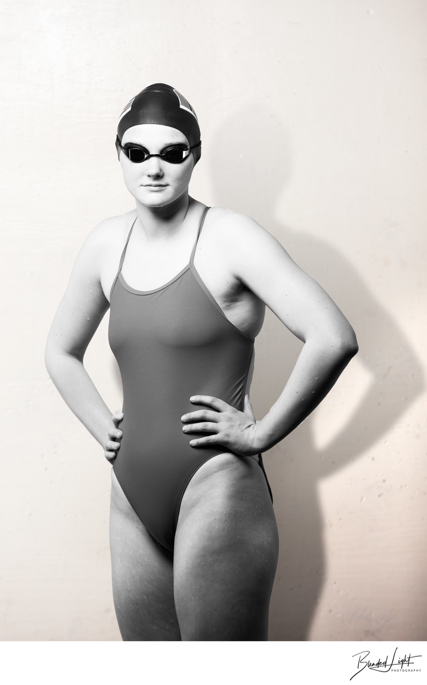 Swimmer portrait against white wall in training area