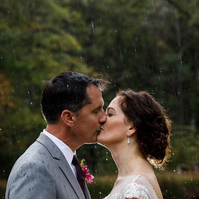 Backlit rainy day wedding portrait