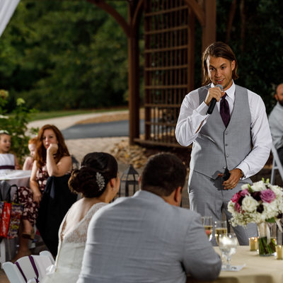 Best man giving wedding reception toast in Apex
