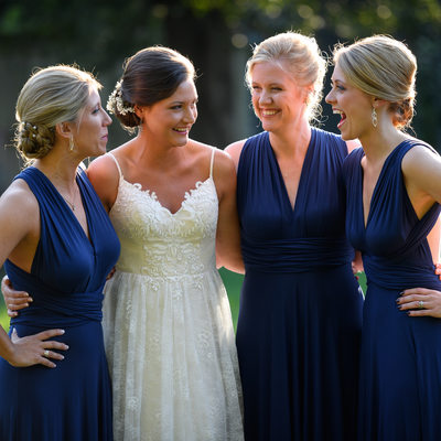 Bride and bridesmaids having a laugh together