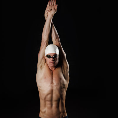 Triathlete showing his streamline position for swimming