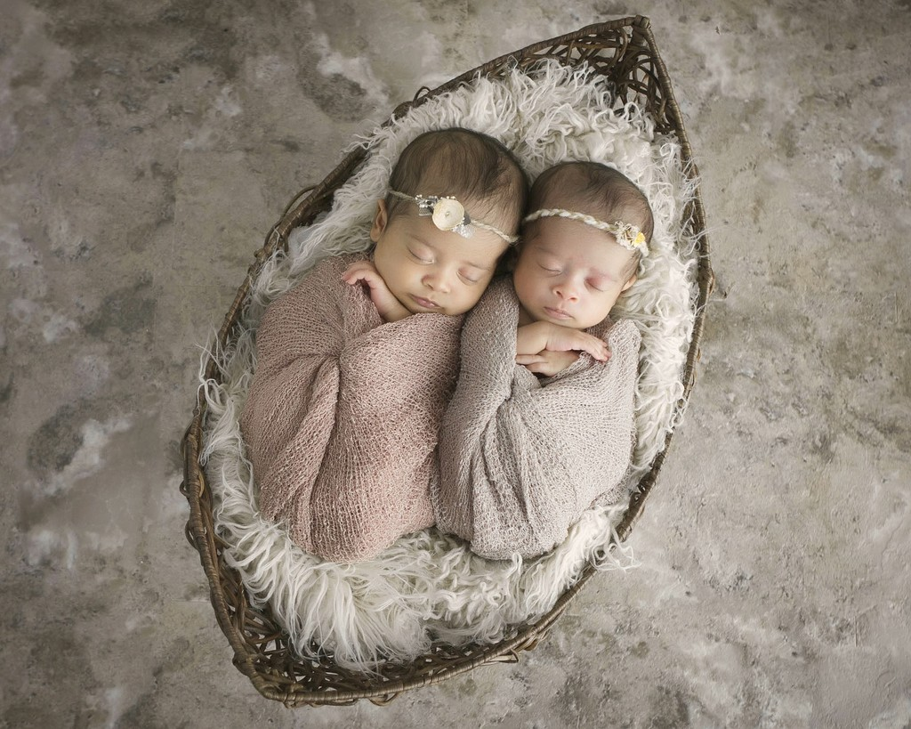 Sweet photography of newborn twin girls