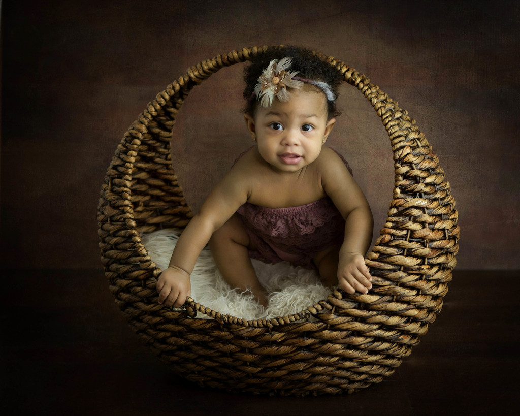 Baby girl a round basket