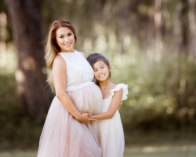 Mother and daughter maternity photo