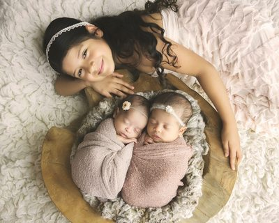 Taking photos of newborn twins and a sibling