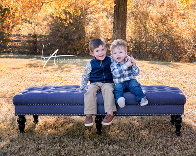 photo of brothers on a bench outdoors