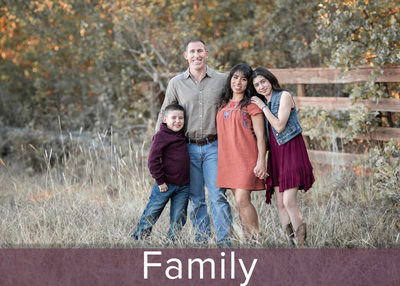 Family photography in a field outside