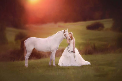 sunset photo in Tyler Texas with a white horse and teenage girl