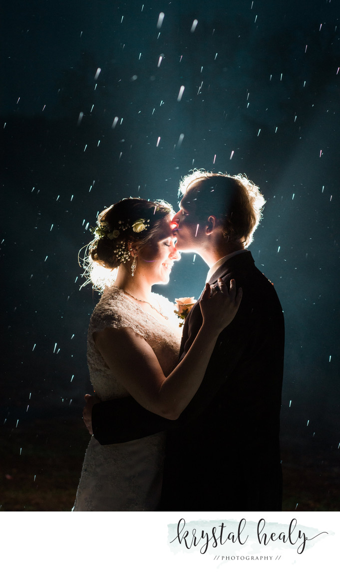 Pittsburgh Couple kissing in the rain on their wedding