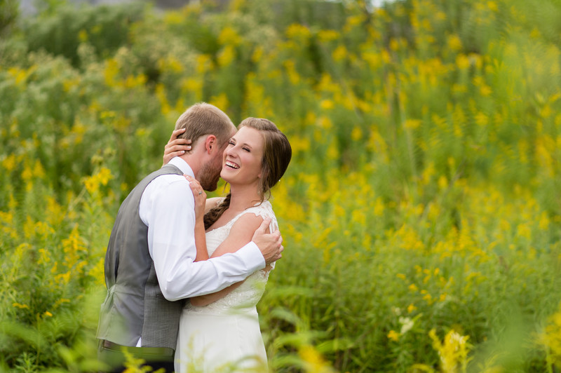 Riveredge Nature Center Wedding couple in flower field
