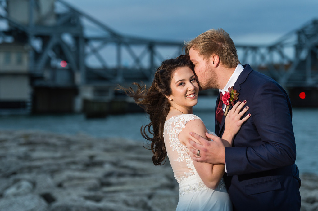 Sturgeon Bay wedding bride and groom portrait with bridge at dusk