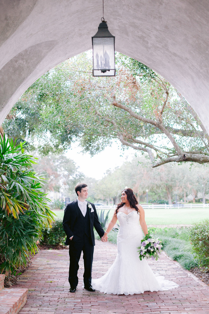 Bride & Groom Portrait stand under arch at Casa Feliz