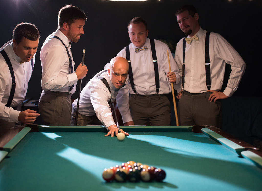 The groomsmen shooting pool