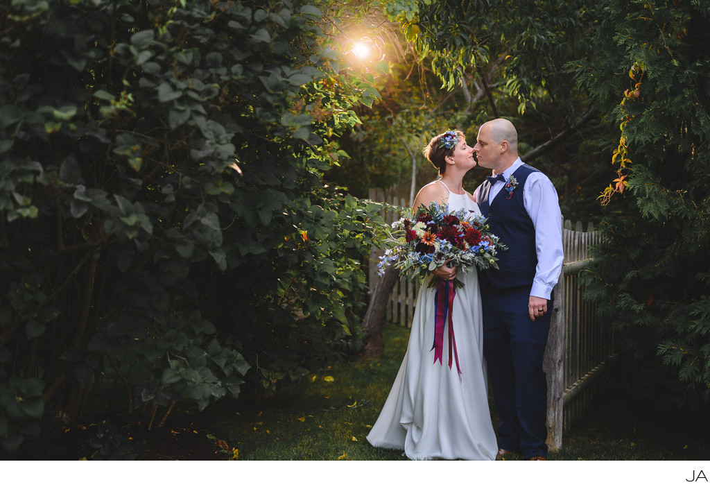 A wedding kiss in a secret garden