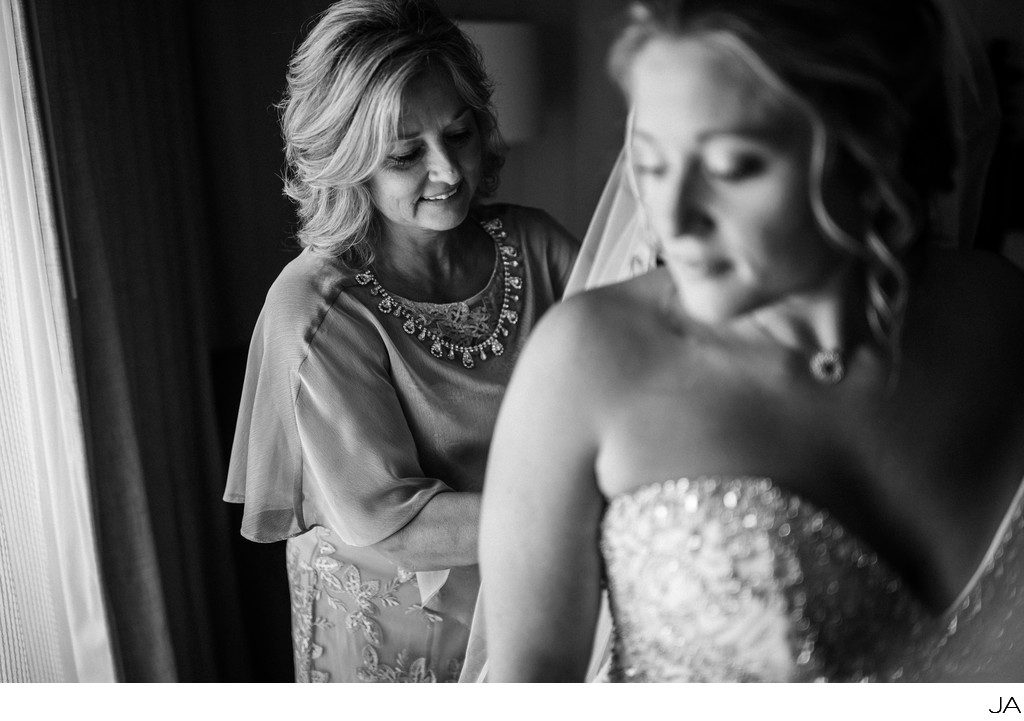 Bridal Prep - Mother lacing up the back of her dress