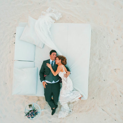 Destination wedding bride & groom on the beach