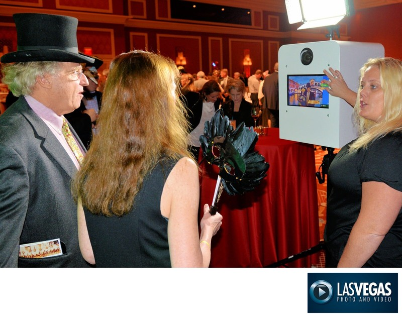 photo booth corporate party guests viewing their photos
