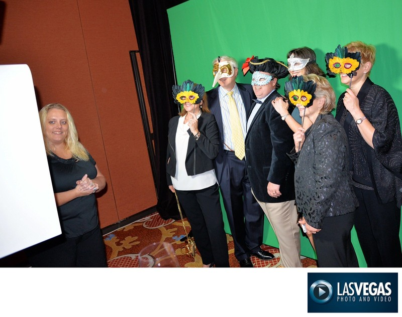 corporate event photo booth masked guests posing
