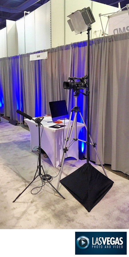 corporate videographer interview set-up at booth