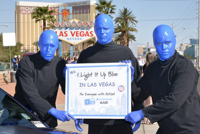 PR photography of the Blue Man Group at the Vegas sign