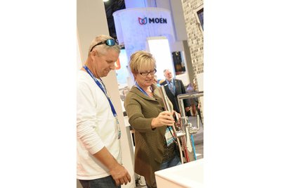 trade show photographer Moen Booth with customers