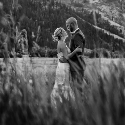 Wedding couple in squaw valley meadows at sunset