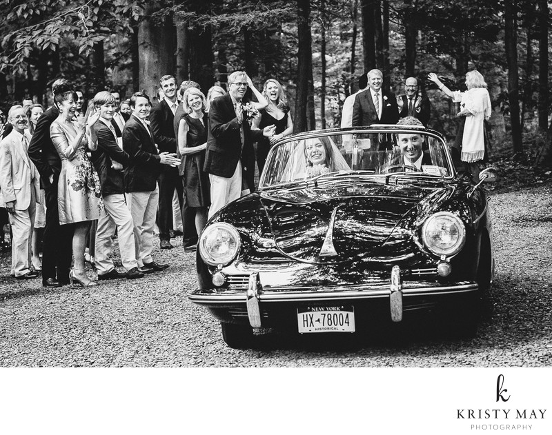 Couple Depart their Wedding Ceremony in a Vintage Car
