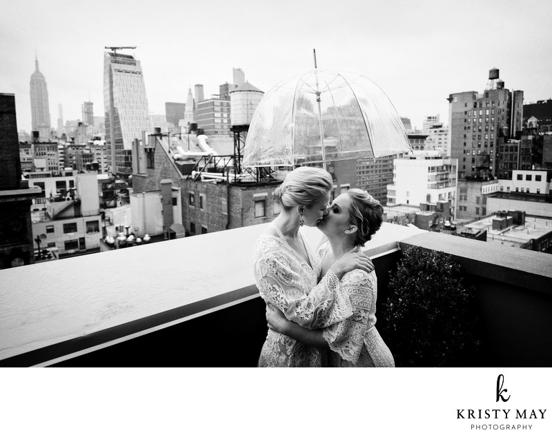 Brides kiss in rain on NYC rooftop on their wedding day