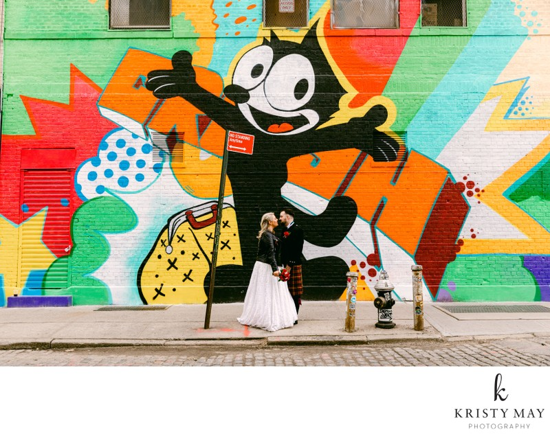 Wedding couple with street art mural in NYC