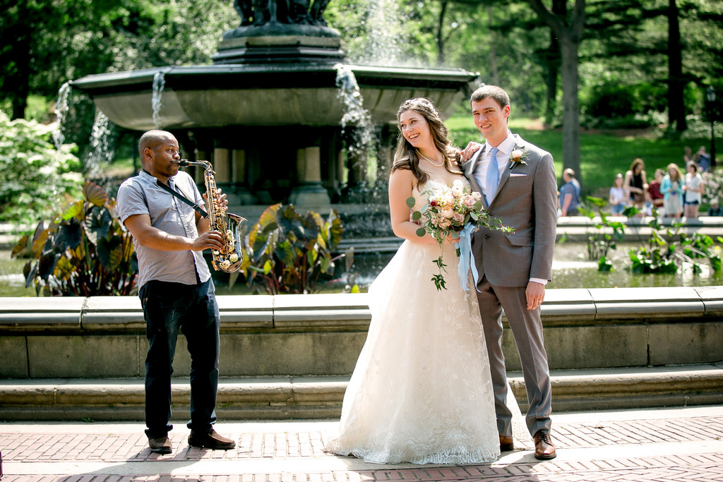 Eloping couple get a serenade at the Bethesda Fountain