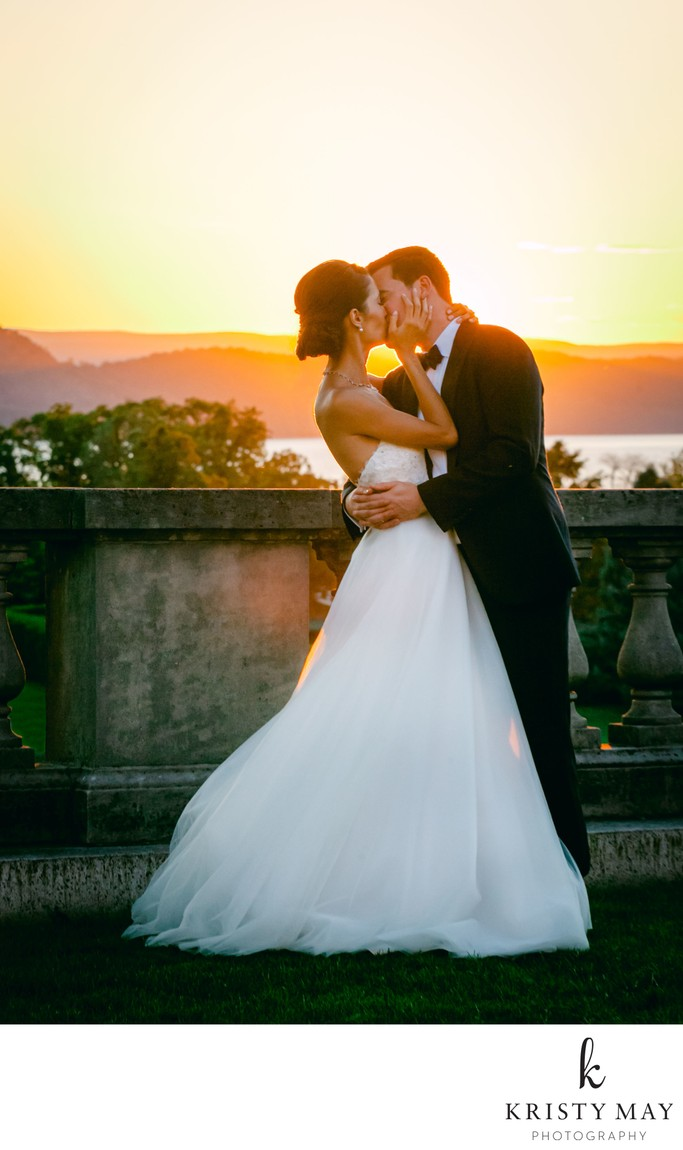 Sunset wedding kiss at Sleepy Hollow Country Club