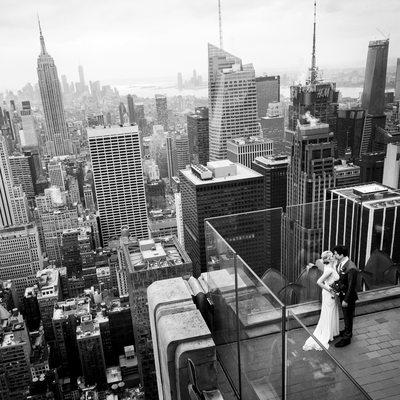 Bride and Groom Kiss on the Viewing Deck of Top of The Rock