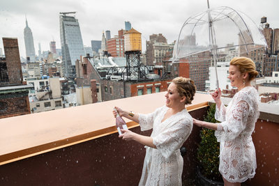 Brides pop champagne on NYC rooftop to celebrate