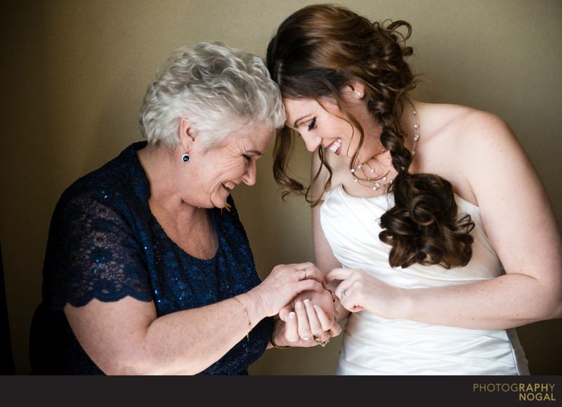 Bride and Mom Putting On Bracelet