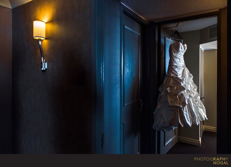 Wedding Dress Hanging At The Doorway