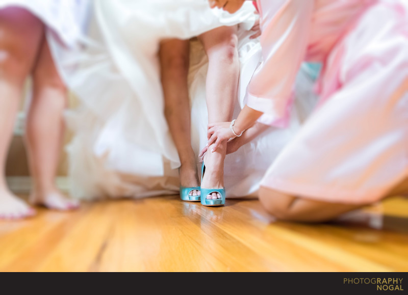 Bridesmaid Helping With Wedding Shoes