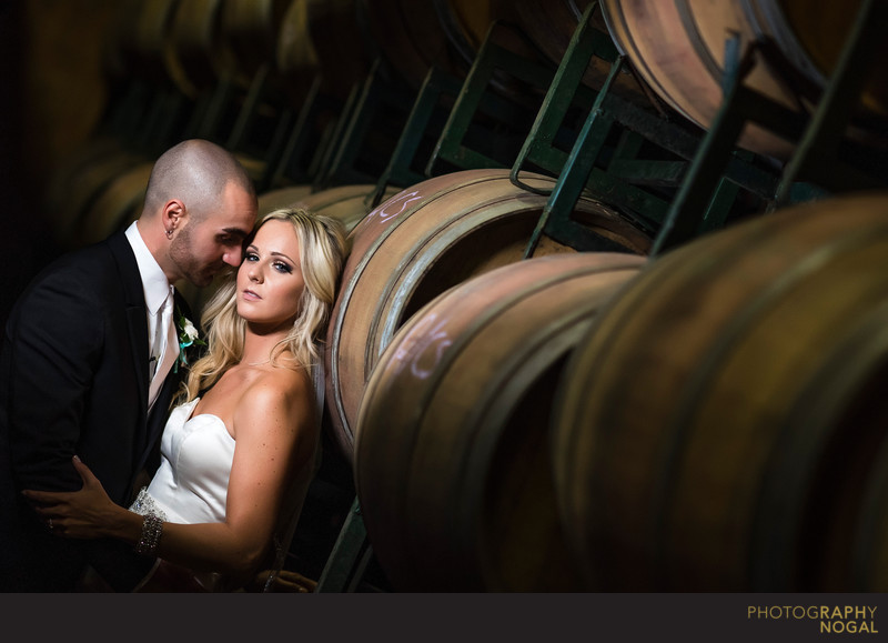 Bride and Groom in Barrel Room at Hernder Estate Wines