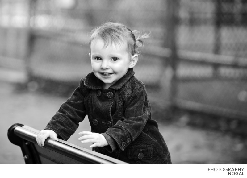 Girl smiling at camera in black and white