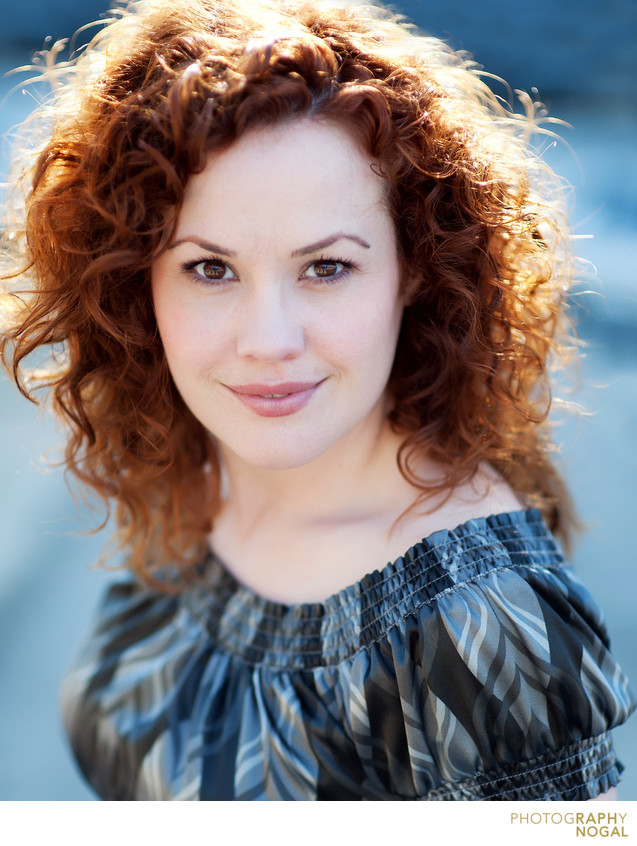 environmental portrait of red haired female actor
