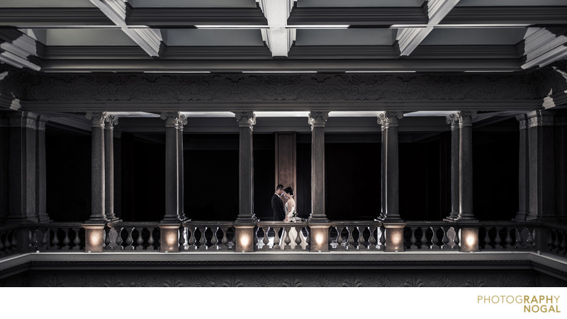 Dynamic and dramatic balcony wedding photograph
