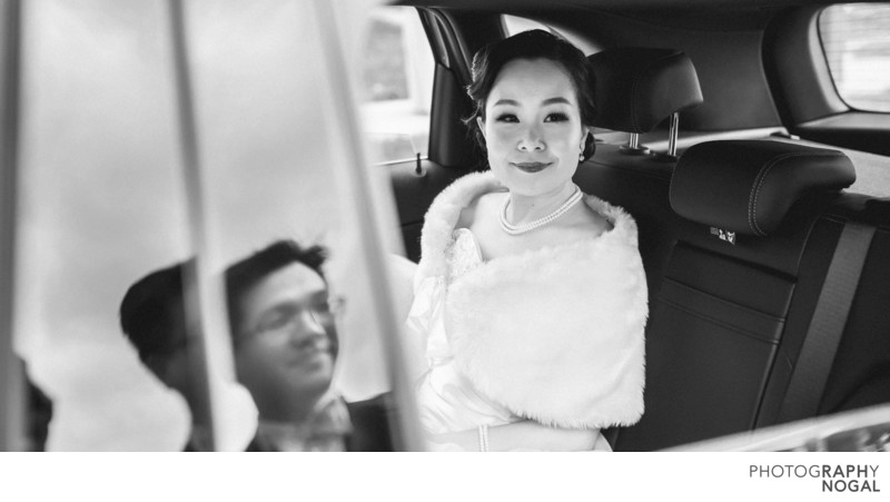 Bride In Car Looking At Groom and Groom's Reflection