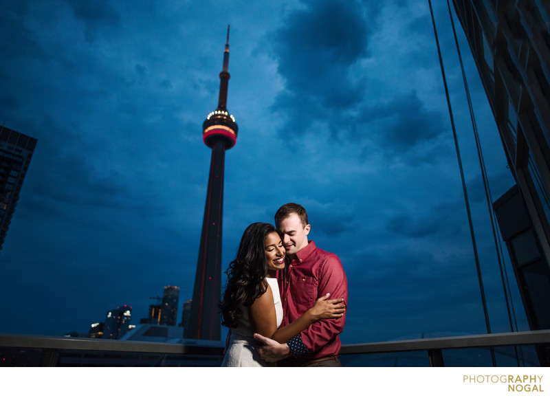 Embrace On A Rooftop by the CN Tower