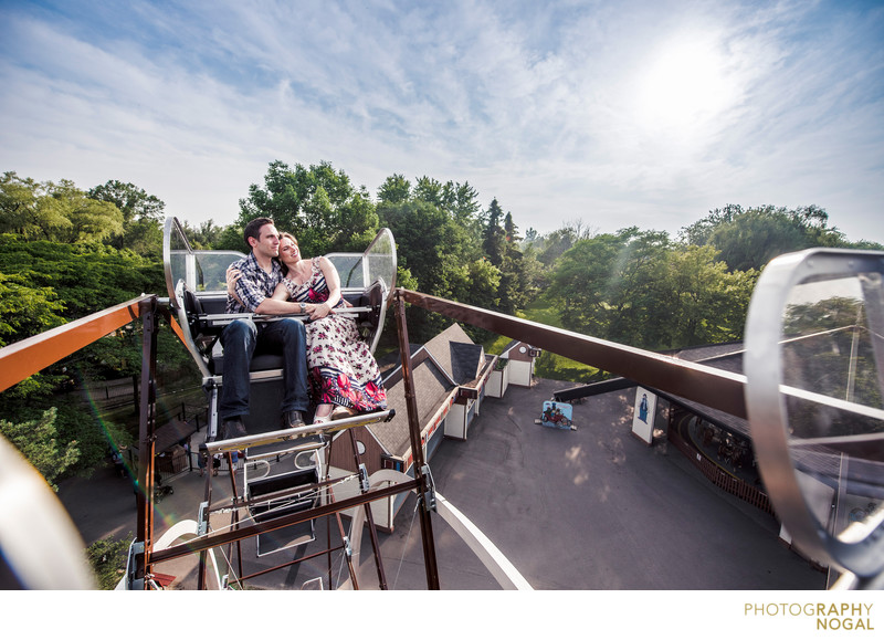 Couple on top of ferris wheel on Toronto Island.