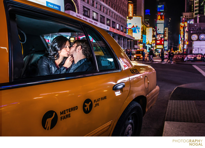 Couple Kissing in NYC Taxi Cab in Times Square