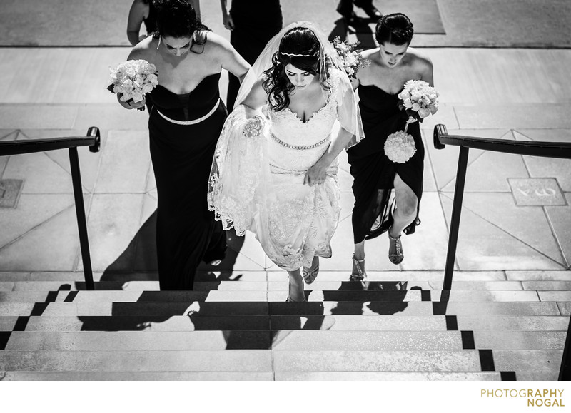 Bride and Bridesmaids Walking Up To The Church