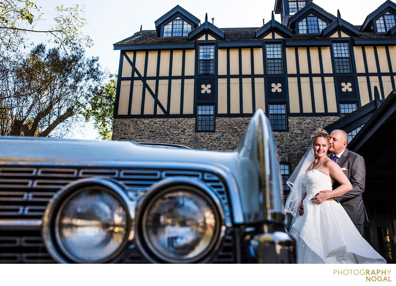 Bride and Groom Next To Classic Car at Old Mill Toronto