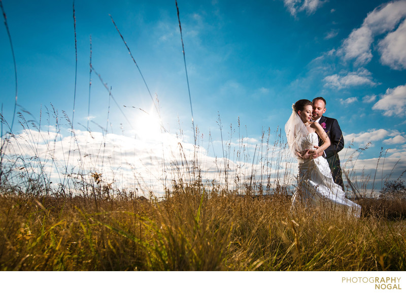 Hugging during Sunset at Sam Smith Park on Wedding Day